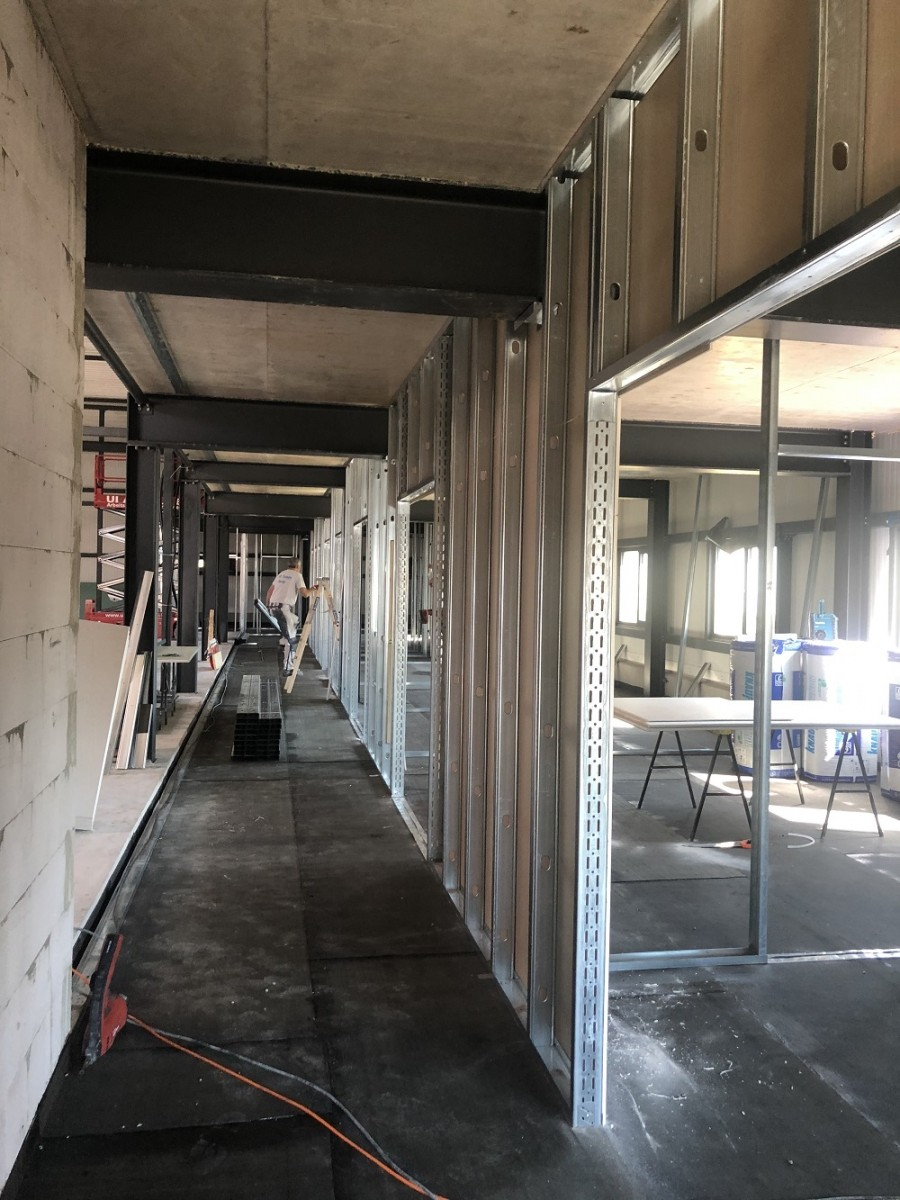 The drywall construction in the administration section is running at full speed